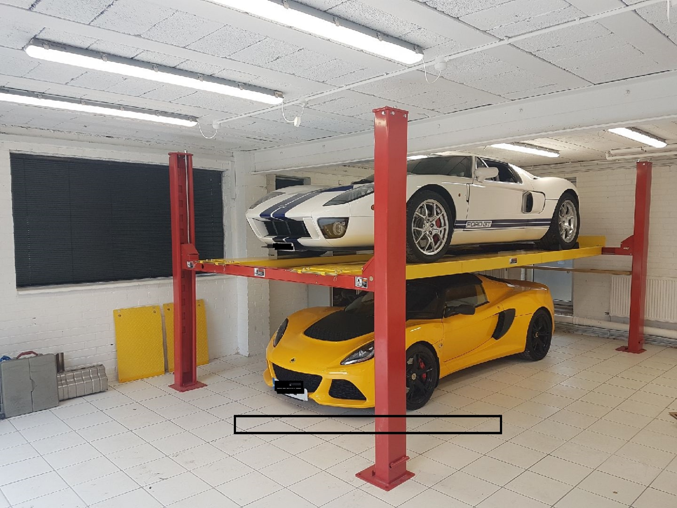 Garage Car Lift For Storage 4 Post Car Lifts Sjr Garage Equipment