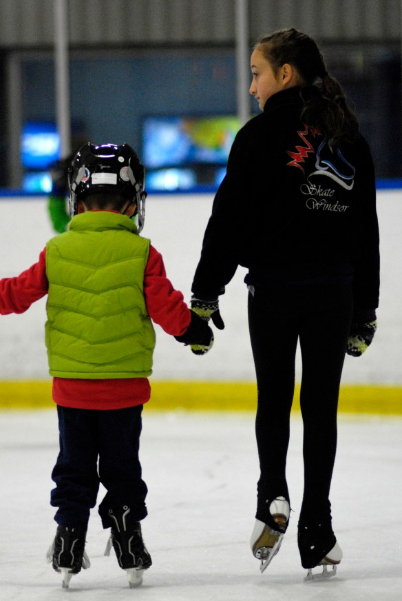 Megan holding hands with CanSkater
