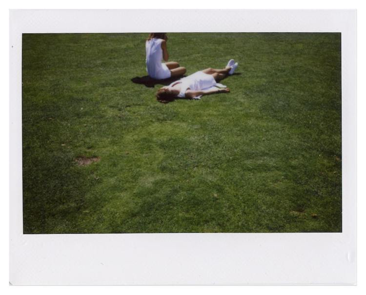 Tennis whites and green grass polaroid