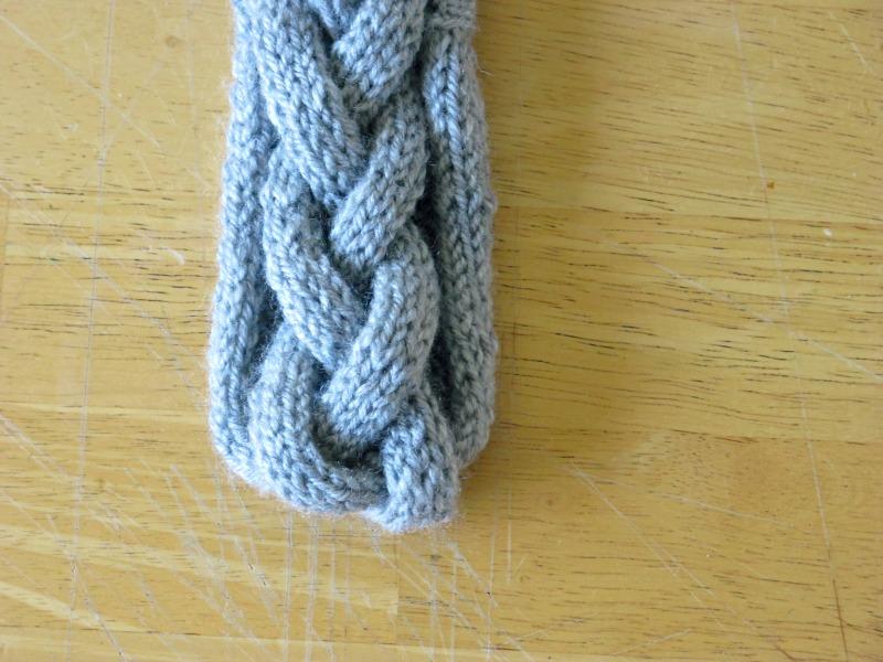 braided grey headbank hand knitted closeup