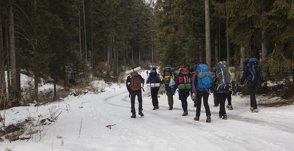 Group Hiking on Snowy Trail