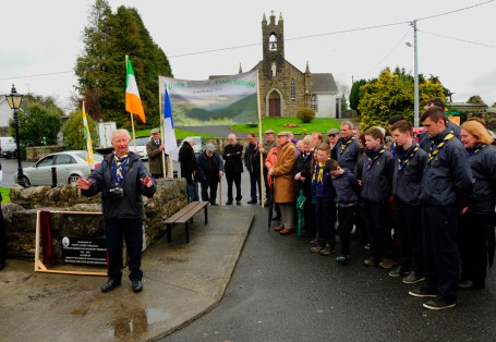 The crowd listen to Jack Ryan, Scout Leader as he pays tribute to Paddy Lowry
