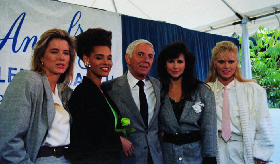 05 May 1988, Los Angeles, California, USA --- Original caption: Hollywood: Aaron Spelling joins his Angels '88 cast members as he announces that the most extensive talent search ever conducted is over. Some 20,000 women were interviewed for the roles before, (L-R) Tea Leoni, Sandra Canning, Karen Kopins and Claire Yarlett were given the parts. It was Spelling who brought Charlie's Angels to the TV in the late '70's. --- Image by © Bettmann/CORBIS