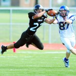 Playing in the Homecoming game, Senior Logan Rose intercepts an opponents pass.