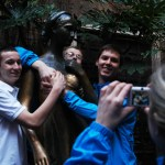 """Students took pictures with the statue of Juliet in Verona, Italy. """"A couple guys or girls would go up at one time and kind of do a funny pose with it and everyone would take a picture of it,"""" said junior Chris Watkins (left). Photo by Molly Howland."""