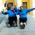 """Junior Katey Magee (left) and senior Tori Holt during free time in the main square in Verona, Italy. They spotted """"this pretty building [that had] this really fun-looking ramp on the steps,"""" Holt said, """"so we just decided to slide down it."""" Photo by Molly Howland."""