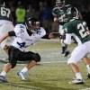 Senior Sam Stewart grabs for a tackle. Photo by Jake Crandall