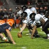 The Lancers prepare to hike the ball. Photo by Erin Reilly.