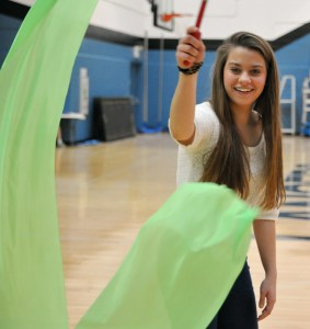 Junior Angela Lanza practices twirling a ribbon for the Chinese New Year performance.