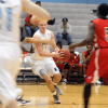Looking for an open pass, Senior Zach Schneider  dribbles. Photo by Paloma Dickey