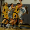 Lancers fighting for the ball in their game against Olathe-South Photo by Hayden Roste