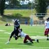 Running back Jackson Gossick breaks a tackle. Photo by Julia Poe