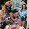 Senior Maddie Hise dances on the cheer float. Their theme was tacky tourists. Photo by Mckenzie Swanson