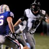 Junior Sam Williams blocks Olathe North offensive lineman Tyler Bacon. Photo by Marisa Walton
