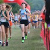 Sophomore Tess Iler attempts to pass other runners in the final stretch of the race. Photo by Neely Atha