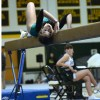 Freshman Kalin Lamus clings to the beam. Photo by Annika Sink.