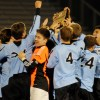 The team celebrates with the Regional plaque after the game. Photo by Mckenzie Swanson