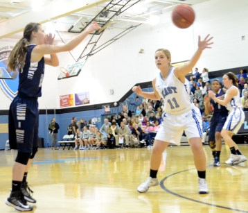Senior Brit Hoffman tries to block a pass from the Blue Valley North player.  Photo by Meghan Shirling