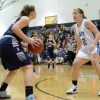 Senior Emily Dodd comes up to get ready to guard the Blue Valley North player.  Photo by Meghan Shirling