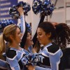 Senior cheerleaders Danya Issawi and Sammie Pfeifauf cheer at the end of the game.  Photo by Hailey Hughes