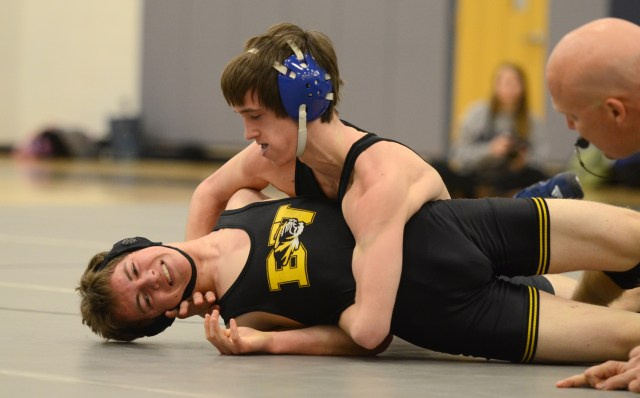 Sophomore Michael Aldrich, who has been on varsity for two years, wrestles opponents. Photo by Katie Lamar