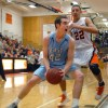 Sophomore Joey Wentz takes a power dribble under the basket while guarded by Brady Skeens. Photo by James Wooldridge