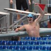 Junior Patrick Hornung celebrates senior Zack Holbrook's win in the 100-yard freestyle. Holbrook finished with a time of 46.69 seconds. Photo by James Wooldridge