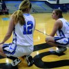 Brit Hoffman and Emily Dodd chat before they sub in for another player. Photo by Neely Atha