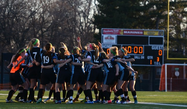 The team joins together to get hyped up before the game. By Katie Lamar