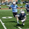Junior Jackson Gossick races another player to the ball. Photo by Annika Sink