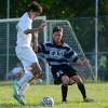 Andrew Mulligan fights for the ball. Photo by Annika Sink