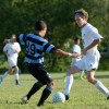 Senior Kyle Neidl dribbles the ball down field. Photo by Annika Sink