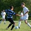 Senior Kyle Neidl dribbles the ball down field. Photo by Annika Sink