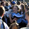 Juniors Brooke Erikson and Hannah Eldred hug after spotting each other in the crowd. Photo by Hailey Hughes