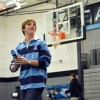 Senior Pep Club exec John Aliber gets ready to toss a shirt into the stands. Photo by Julia Poe