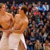 Seniors Benn Schmatz and Mitch Kerr dance with each other for the swim team performance. Photo by Julia Poe