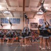 The cheerleaders perform their competition routine at the beginning of the pep assembly. Photo by Callie McPhail
