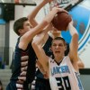 Junior Jay Guastello drives into the lane and draws the foul. Photo by James Wooldridge