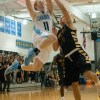 Senior Jack Flint goes up for a layup and gets fouled by West's sophomore Zach Witters. Photo by James Wooldridge