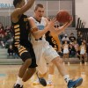 Junior Jay Guastello drives by West's sophomore Isreal Watson. Guastello had 11 points. Photo by James Wooldridge