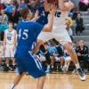 Junior Joey Wentz battles for an offensive rebound. Photo by James Wooldridge