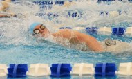 Max Keeter finishes the 400 yard Freestyle relay with a final time of 3:29.49. Photo by Annie Lomshek.