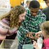 Junior Anna Witwer observes as a kid pets a salamander. Photo by Morgan Browning