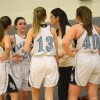 The team huddles after the Raiders scored four points off of turnovers by the Lancers. Photo by Kylie Rellihan