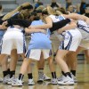 The Lady Lancers gather together at half court and perform a chant before the start of the game. Photo by Joseph Cline