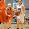 Senior Emma Braasch drives in the lane for a layup. Photo by Joseph Cline