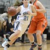 Senior Hannah Nick drives past a defender and finds a lane to the basket. Photo by Joseph Cline