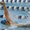 Junior Adam Bublitz gasps for breath during the 100-yard backstroke. Photo By Annie Lomshek