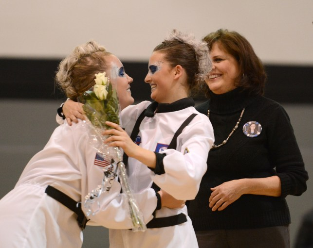 Sophomore Anna Dierks gives a rose to senior Audrey Phillips during the Lancer Dancer Senior Night. Photo by Katie Lamar