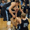 Junior Jay Guastello and teammates help up Senior Max Danner after he was knocked down. Photo by Ali Hickey.